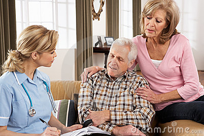 Senior Couple Talking To Health Visitor