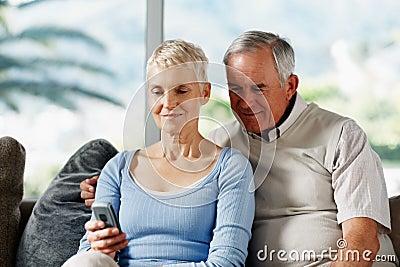 Senior couple text messaging