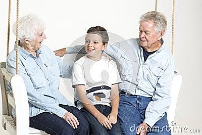 Senior couple with their grandson