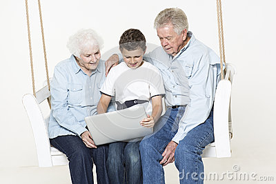 Senior couple with their grandson