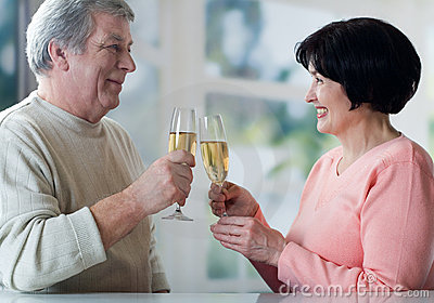 A senior couple toasting their years together with champag