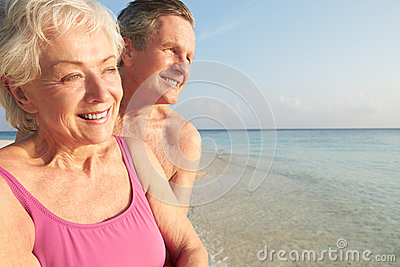 Senior Couple On Tropical Beach Holiday