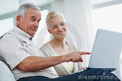 Senior couple using a laptop while at home