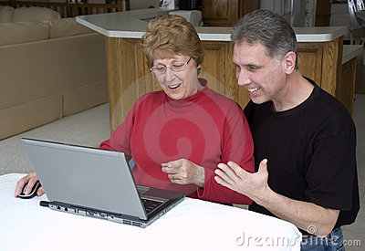 Senior Couple Using Laptop, Internet, Technology