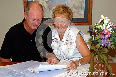 Senior couple viewing house plans