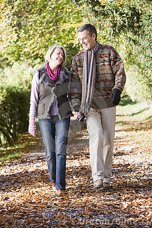 Free Senior Couple Walking Along Autumn Path Royalty Free Stock Photo - 5304965