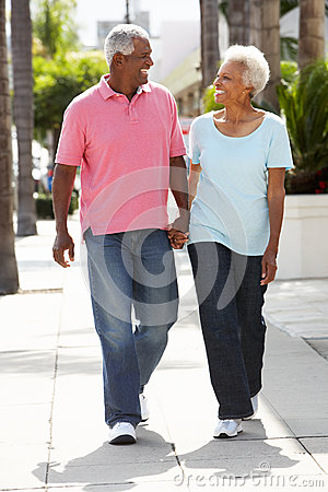 Senior Couple Walking Along Street Together Royalty Free Stock Image - Image: 27959796