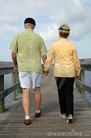 Senior couple walking back view