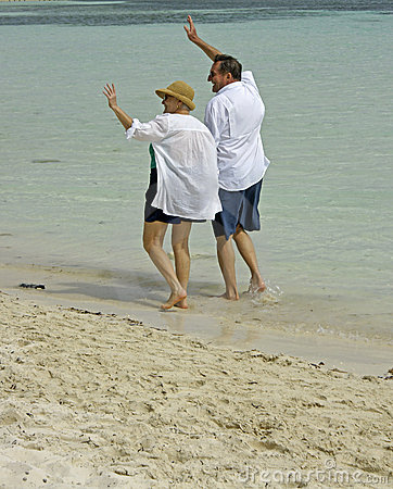 Senior couple walking beach