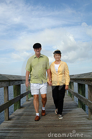 Senior couple walking on boardwalk