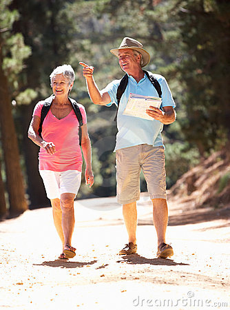Senior couple walking in country