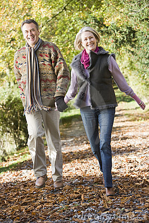 Free Senior Couple Walking Through Autumn Woods Royalty Free Stock Photography - 5305017