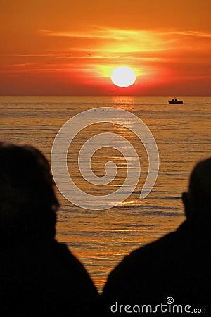 Free Senior Couple Watching Sunset Royalty Free Stock Photos - 8489328