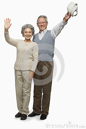 Senior couple waving goodbye
