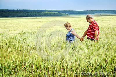Senior couple in wheat field