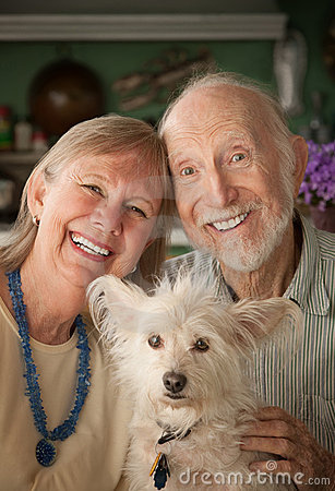 Free Senior Couple With Dog Royalty Free Stock Photography - 16614427