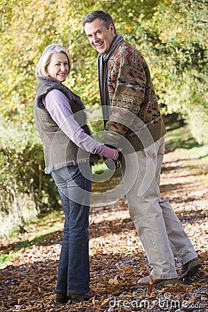 Senior couple on woodland walk