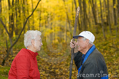 Senior couple in the woods.