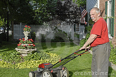 Senior Ctizen Mowing Lawn
