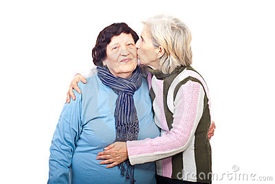 Senior daughter kissing elderly mother