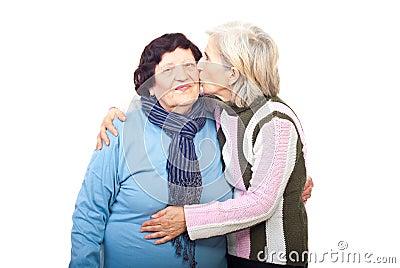 Senior daughter kissing elderly mother