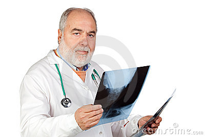 Senior doctor with hoary hair with a radiography