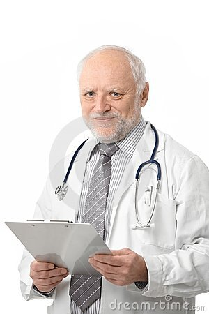 Senior doctor holding papers smiling