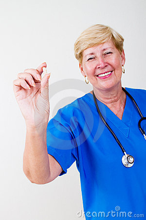 Senior doctor holding pill