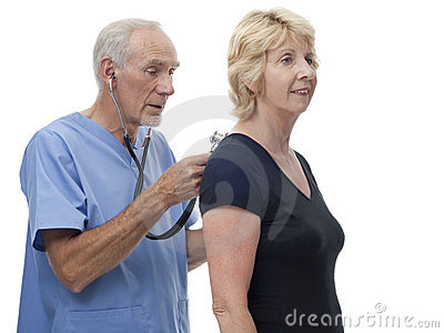 Senior doctor in scrubs with stethoscope