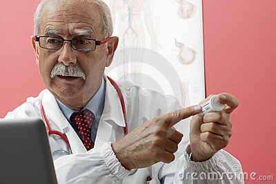 Senior Doctor Using Webcam