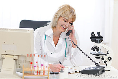 Senior doctor woman speaking phone at office
