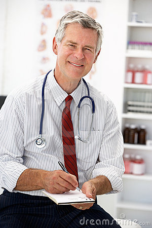 Senior doctor writing prescription