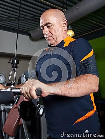 Senior doing triceps exercises