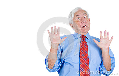 Senior executive man with hands up, surprised, shocked, scared,