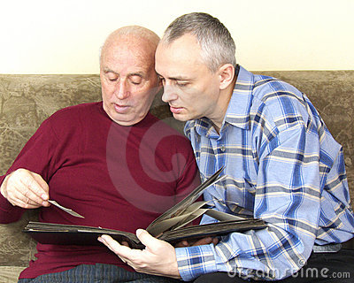 Senior father and son sharing memories