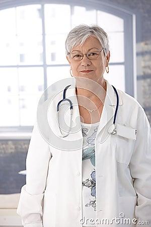 Senior female doctor in lab coat