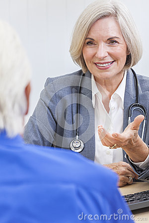 Stock Image: Senior Female Doctor With Male Patient