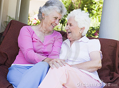 Senior female friends chatting together