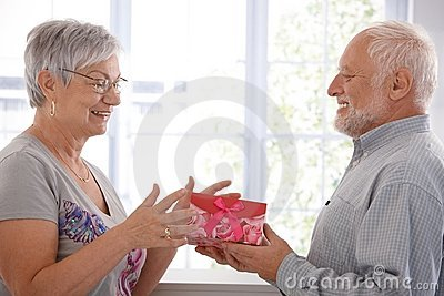 Senior female getting present from husband
