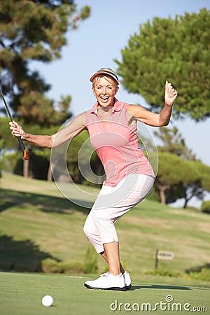 Senior Female Golfer On Golf Course