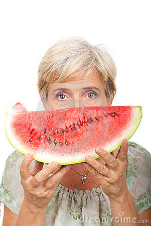 Senior female holding watermelon
