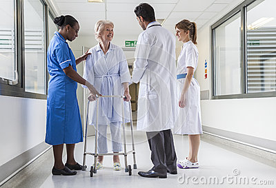 Senior Female Hospital Patient in Walking Frame Doctor Nurse