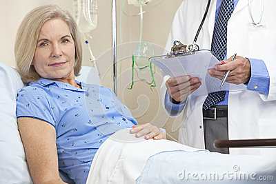 Senior Female Woman Patient In Hospital Bed