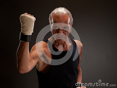Senior fighter posing with clenched fist