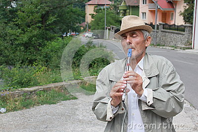 Senior with a flute Editorial Stock Image