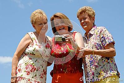 Senior friends checking photo