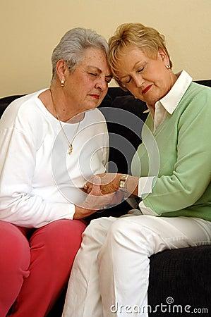 Senior friends comfort/prayer