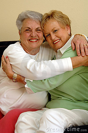 Senior friends hugging