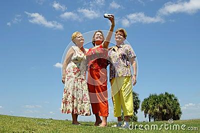 Senior friends taking photo