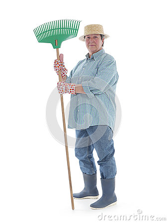 Senior gardener with rake